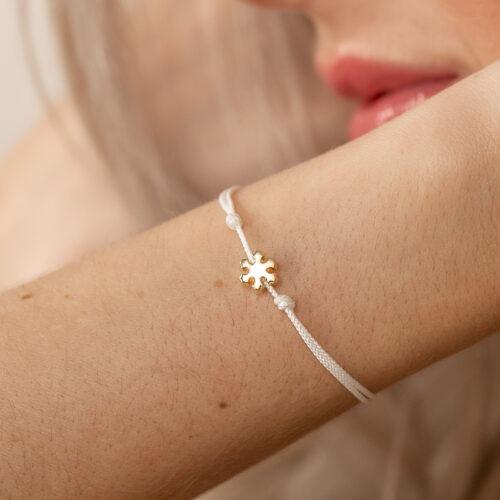Schneeflocke gold auf Nylonband als Armband